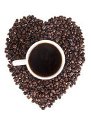 Heart of the coffee beans with a cup of coffee in the heart on a white background — Stock Photo