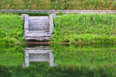 Stairs by the water — Stock Photo