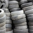 Royalty-Free Stock Photo: Background with old tires on each other