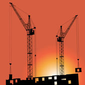 Silhouettes of crane on building against — Foto Stock