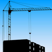 Silhouette of one cranes working on the building on a blue backg — Stock Photo