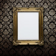 Royalty-Free Stock Photo: Blank frame at the wall with clipping path