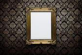 Blank frame at the wall with clipping path — Stock Photo