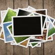 Stack of photos at wooden background — Stock Photo #11756412