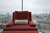 Armchair in a floor to ceiling window with panoramic London view — Stock Photo