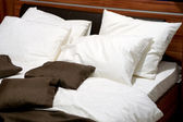 Nice pillows on a contemporary bed — Stock Photo