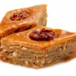 Oriental sweets baklava on a white background — Stock Photo #10929337