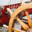 Steering wheel of an ancient sailing vessel - Stock Photo