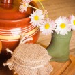 Stock Photo: Still life with honey, flowers and pot