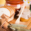 Honey, flowers, spike and bread on table — Stock Photo