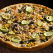 Pizza alle verdure with vegetable marrow, corn, olives and mushrooms - isolated — Stock Photo