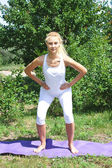 The girl involved in fitness in the village — Стоковое фото