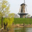 Statue of the fisherman on the background of a windmill in Gorin — Stock Photo