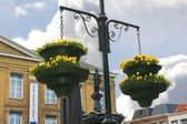 Pots of flowers in the town square in Gorinchem. Netherlands — Stock Photo