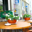 Flowers on the tables of street cafes. Gorinchem. Netherlands — Stock Photo