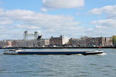 Barge on backdrop of waterfront of Rotterdam. Netherlands — Stock Photo