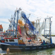 Fishing ships in the port of Volendam. Netherlands - Stock Photo