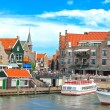 Tourist boat in the port of Volendam. Netherlands - Stock Photo