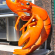 A stuffed lobster near a fish shop in Volendam. Netherlands - Stock Photo