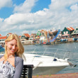The girl at port of Volendam. Netherlands - Stock Photo