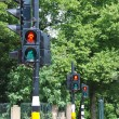 Three red traffic lights in row — Stock Photo #12323342
