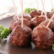 Grilled meatballs and parsley — Stock Photo #10879763