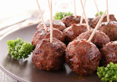 Grilled meatballs and parsley — Stock Photo