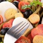 Mixed salad and fork — Stock Photo