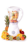 Blender with assortment of fruits — Stock Photo