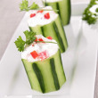 Stuffed cucumber with cream and pepper — Stock Photo