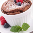 Chocolate souffle with berries fruits — Stock Photo