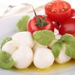 Mozzarella, tomato ,basil and olive oil — Stock Photo #11853846