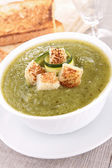 Bowl of vegetable soup with crouton — Stock Photo
