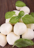 Mozzarella ball and basil — Stock Photo