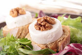 Bread with goat cheese and walnut — Stock Photo