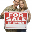 Royalty-Free Stock Photo: Military Couple Holding A For Sale By Owner Sign