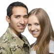 Smiling Military Couple Pose for a Portrait - Stock Photo