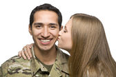 Woman Kisses Latino Serviceman on the Cheek — Stock Photo