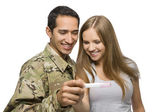 Military Man and His Wife Smile at Pregnancy Test — Stock Photo
