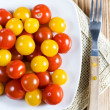 Red and yellow cherry tomatoes — Stock Photo #10895072