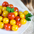 Red and yellow cherry tomatoes — Stock Photo #10990529