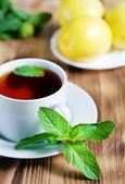 Tea with mint and lemon — Stock Photo