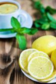 Lemons and tea with mint — Stock Photo