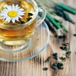 Tea with chamomile and herbs — Stock Photo
