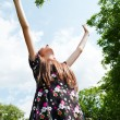 Teen girl with raised hands — Stock Photo #11189132