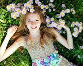 Teen girl lying in grass — Stock Photo