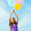 Teen girl at a wheat field with balloons — Stock Photo #11417858