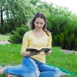 Royalty-Free Stock Photo: Teen girl reading book