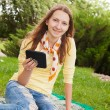 Teen girl reading electronic book — Stock Photo