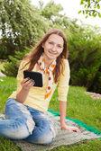 Teen girl reading electronic book — Stockfoto